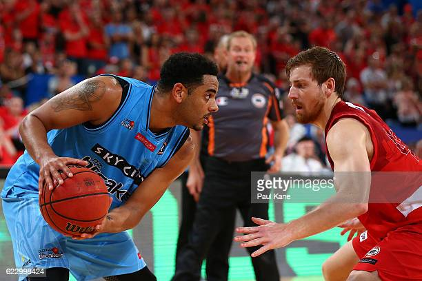 Corey Webster of the Breakers looks to take on Corban Wroe of the Wildcats during the round six NBL match between the Perth Wildcats and the New...
