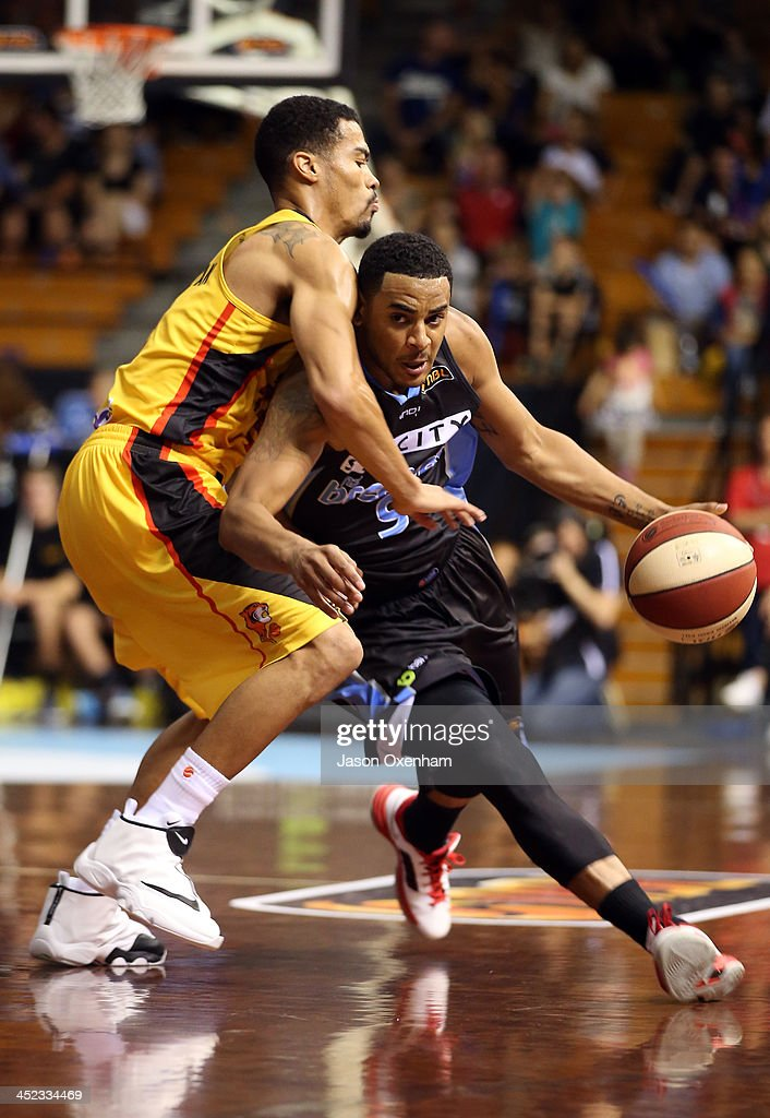 Corey Webster of the Breakers runs into Mustapha Farrakhan of the Melbourne Tigers during the round eight NBL match between the New Zealand Breakers and the Melbourne Tigers at North Shore Events Centre on November 28, 2013 in Auckland, New Zealand.