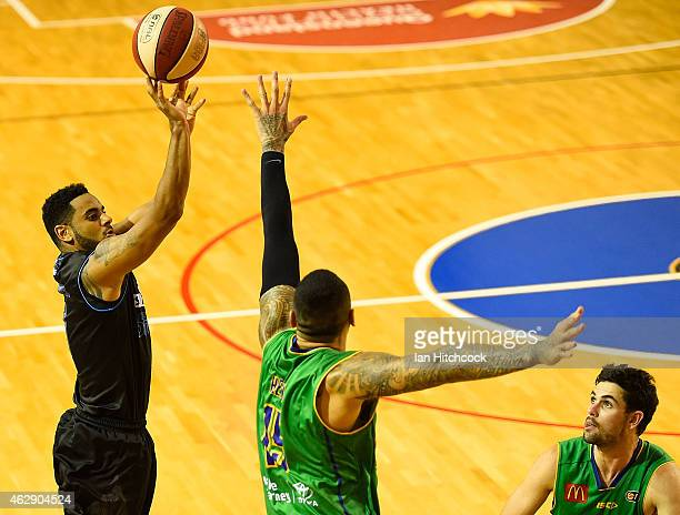 Corey Webster of the Breakers takes a shot over Leon Henry of the Crocodiles during the round 18 NBL match between the Townsville Crocodiles and New...