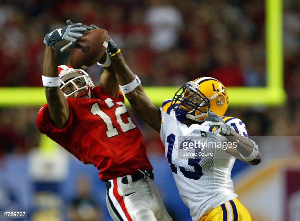 Corey Webster of the LSU Tigers breaks up a pass intended for Sean Bailey of the Georgia Bulldogs during the SEC Championship Game December 6 2003 at...
