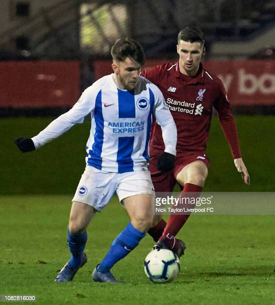 Corey Whelan of Liverpool and Aaron Connolly of Brighton and Hove Albion in action during the PL2 game at The Kirkby Academy on January 14 2019 in...