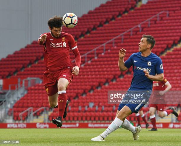 Corey Whelan of Liverpool and Charlie Colkett of Chelsea in action during the Liverpool v Chelsea PL2 game at Anfield on May 8 2018 in Liverpool...