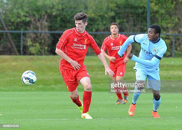 Corey Whelan of Liverpool and Javairo Dilrosun of Manchester City in action during the Barclays Premier League Under 18 fixture between Liverpool and...