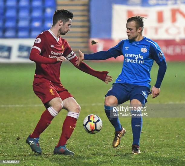 Corey Whelan of Liverpool and Lennerd Daneels of PSV Eindhoven in action during the Liverpool v PSV Eindhoven Premier League International Cup game...
