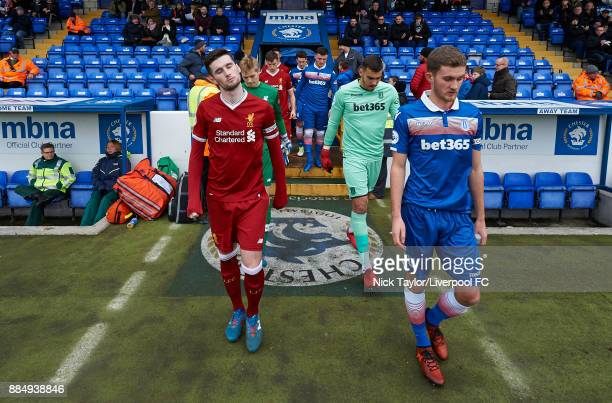 Corey Whelan of Liverpool and Lewis Banks of Stoke City lead their teams to the pitch during the Liverpool v Stoke City Premier League Cup game at...