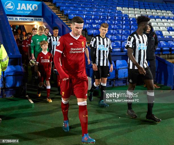 Corey Whelan of Liverpool and Mo Sangare of Newcastle United make their way to the pitch at the start of the Liverpool U23 v Newcastle United U23...