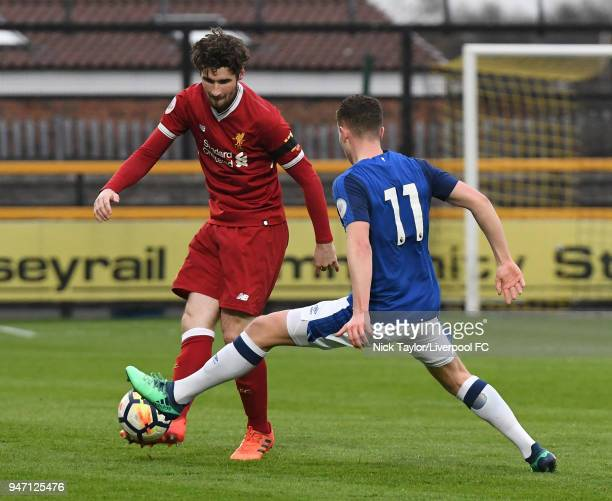 Corey Whelan of Liverpool and Nathan Broadhead of Everton in action during the Everton v Liverpool PL2 game on April 16 2018 in Southport England
