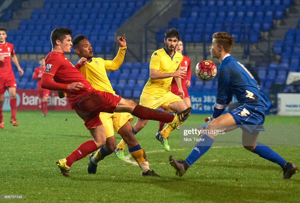 Corey Whelan of Liverpool and Tyler Denton and goalkeeper Bailey Peacock-Farrell of Leeds United in action during the Liverpool v Leeds United U21 Premier League Cup game at Prenton Park on January 19, 2016 in Birkenhead, England.