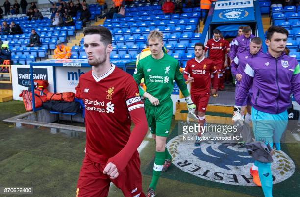 Corey Whelan of Liverpool leads his team on to the pitch at the start of the Liverpool v Bristol City U23 Premier League Cup at The Swansway Chester...