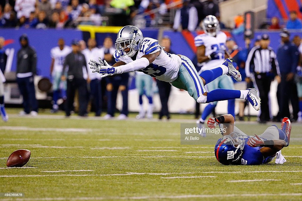 Corey White #23 of the Dallas Cowboys attempts to pick off a dropped pass from Rueben Randle #82 of the New York Giants during the fourth quarter at MetLife Stadium on October 25, 2015 in East Rutherford, New Jersey. The New York Giants defeated the Dallas Cowboys 27-20.