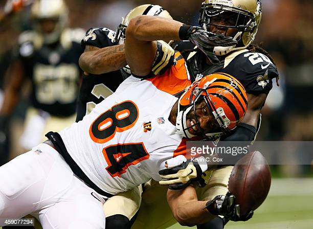 Corey White of the New Orleans Saints forces a fumble by Jermaine Gresham of the Cincinnati Bengals but he recovers it for the touchdown during the...