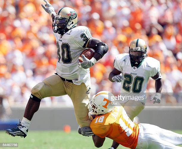 Corey White of UAB is brought down by Jason Allen of Tennessee on September 3, 2005 at Neyland Stadium in Knoxville, Tennessee. The Volunteers...