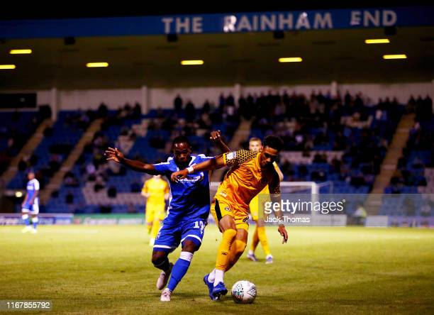 Corey Whitely of Newport County is challenged by Mark Marshall of Gillingham FC during the Carabao Cup First Round match between Gillingham and...