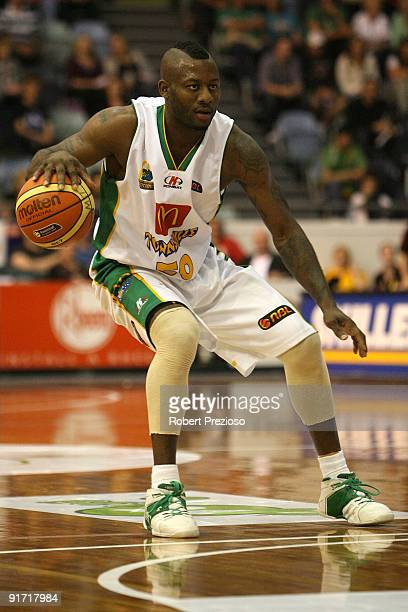 Corey Williams of the Crocodiles controls the basketball during the round three NBL match between the Melbourne Tigers and the Townsville Crocodiles...