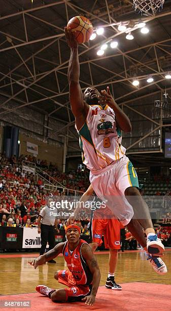 Corey Williams of the Crocodiles drives to the basket past Darnell Hinson of the Wildcats during the NBL quarter final match between the Perth...