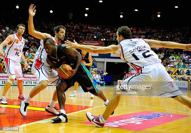 Corey Williams of the Crocodiles makes a drive to the basket through the defence of Glen Saville of the Hawks during game two of the NBL semi final...