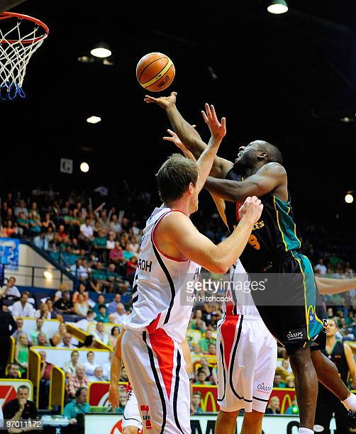 Corey Williams of the Crocodiles makes a layup over Cameron Tragardh of the Hawks during game two of the NBL semi final series between the Townsville...