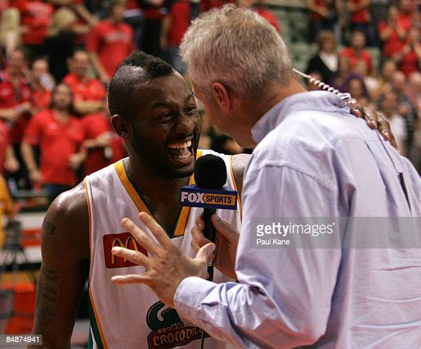 Corey Williams of the Crocodiles talks with Andrew Gaze after winning the NBL quarter final match between the Perth Wildcats and the Townsville...