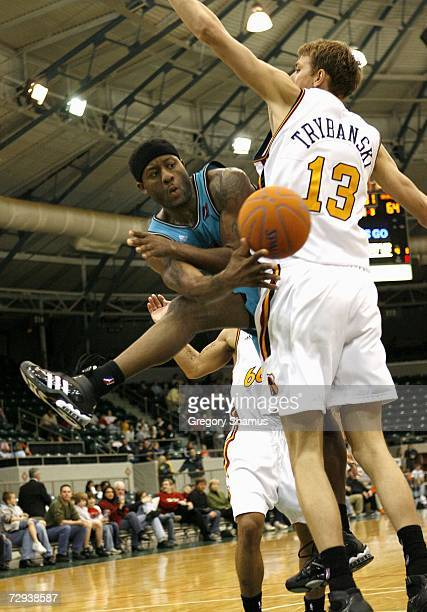 Corey Williams of the Sioux Falls Skyforce makes a pass around Cezary Trybanski of the Tulsa 66ers during a NBDL game at the Expo Square Pavilion...