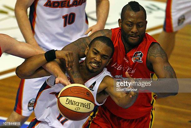Corey Williams of the Tigers and Ron Howard of the 36ers compete for the ball during the round 12 NBL match between the Melbourne Tigers and the...