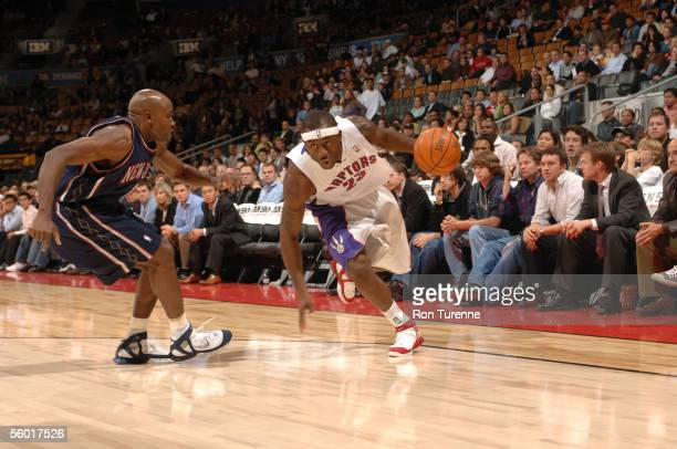 Corey Williams of the Toronto Raptors drives against Jacque Vaughn of the New Jersey Nets during a preseason game October 19 2005 at the Air Canada...