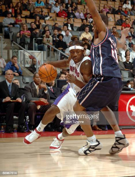Corey Williams of the Toronto Raptors drives to the rim against Antoine Wright of the New Jersey Nets during a preseason game on October 19 2005 at...