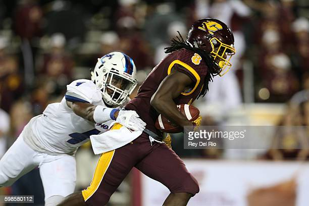 Corey Willis of the Central Michigan Chippewas runs the ball against Kevin Green of the Presbyterian Blue Hose at Kelly/Shorts Stadium on September 1...