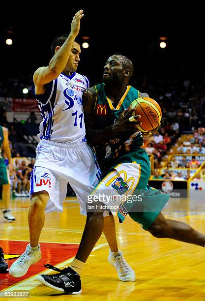 Corey Willliams of the Crocodiles drives past Luke Martin of the Spirit during the round 12 NBL match between the Townsville Crocodiles and the...