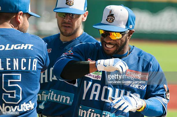 Corey Wimberley of Yaquis de Obregón greets his teammates before start the match against Charros de Jalisco in the first game of semifinals of liga...