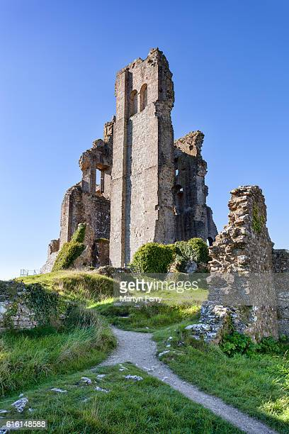 Corfe Castle ruins in the morning sunshine, Isle of Purbeck, Dorset, UK