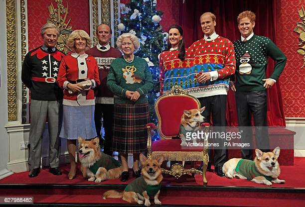 Corgi dogs join wax figures of members of the Royal family in Madame Tussauds London wear their Christmas jumpers to raise awareness of Save the...