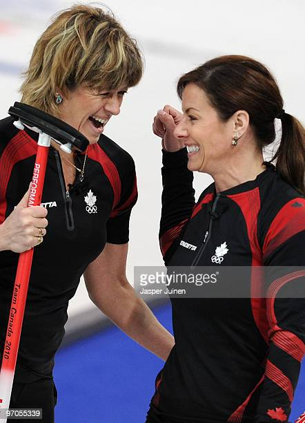 Cori Bartel celebrates with her skip Cheryl Bernard at the end of the women's curling semifinal game between Canada and Switzerland on day 14 of the...