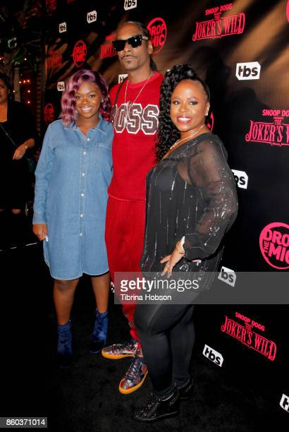 Cori Broadus Snoop Dogg and Shante Broadus attend the premiere for TBS's 'Drop The Mic' and 'The Joker's Wild' at The Highlight Room on October 11...