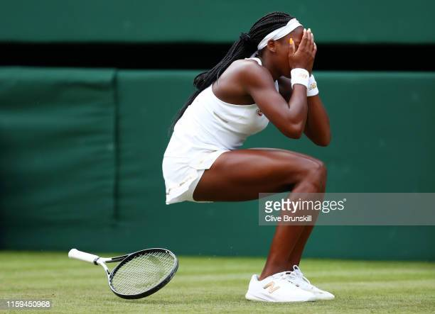 Cori Gauff of the United States celebrates match point in her Ladies' Singles first round match against Venus Williams of The United States during...