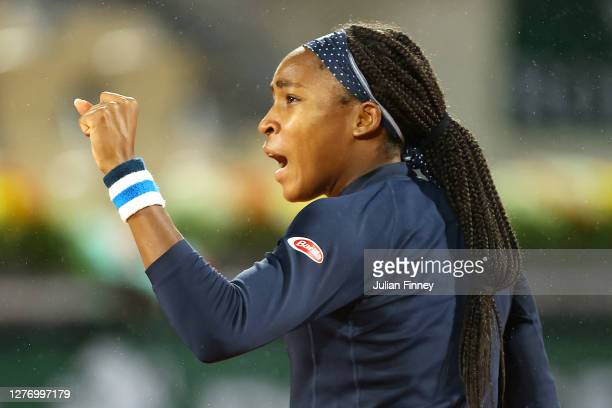Cori Gauff of The United States of America celebrates after winning a point during her Women's Singles first round match against Johanna Konta of...