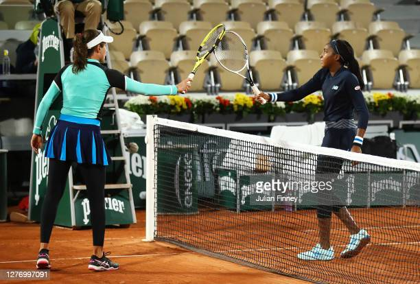 Cori Gauff of The United States of America knocks racquets with Johanna Konta of Great Britain following her victory in their Women's Singles first...