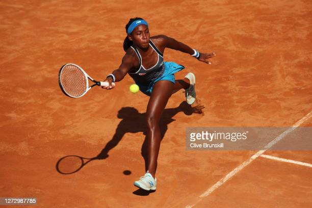 Cori Gauff of The United States stretches to play a forehand in her round two match against Garbine Muguruza of Spain during day four of the...
