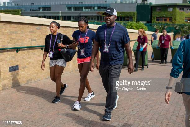 Cori Gauff of the United States with her parents Candi Gauff and Corey Gauff after training before the start of the Wimbledon Lawn Tennis...
