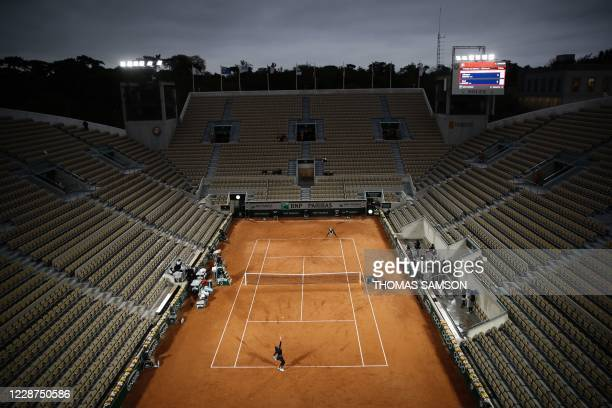 Cori Gauff of the US serves the ball to Britain's Johanna Konta during their women's singles first round tennis match at the at the Suzanne Lenglen...