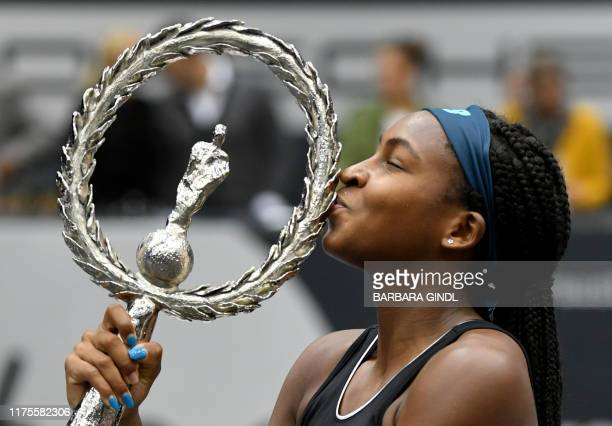 Cori Gauff of US kisses the trophy after she won her WTA-Upper Austria Ladies final tennis match against Jelena Ostapenko of Latvia on October 13,...