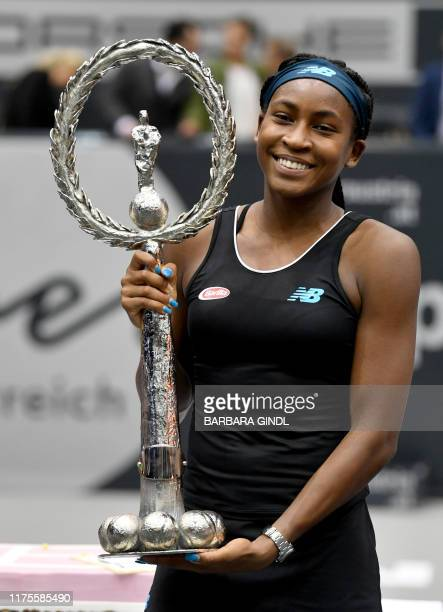 Cori Gauff of US poses with the trophy after she won her WTA-Upper Austria Ladies final tennis match against Jelena Ostapenko of Latvia on October...