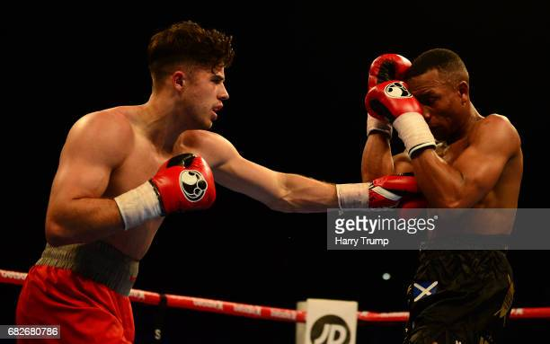 Cori Gibbs punches Ahmed Ibrahim during the SuperLightweight Contest between Cori Gibbs and Ahmed Ibrahim at the Barclaycard Arena on May 13 2017 in...