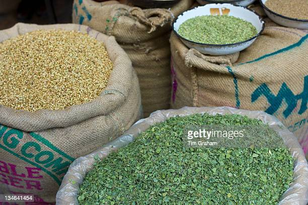 Coriander seeds and dried fenugreek leaves on sale at Khari Baoli spice and dried foods market Old Delhi India