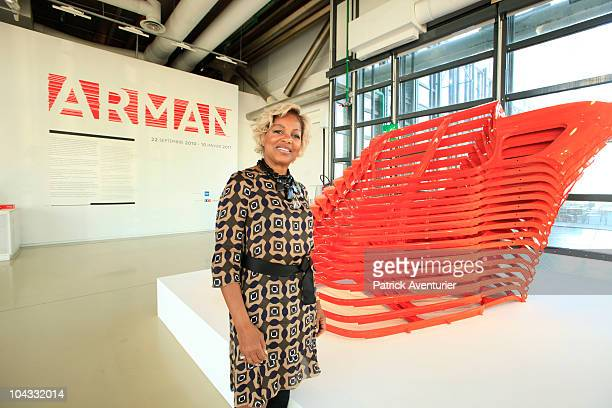 Corice Arman in front the work Accumulation Renault No 101 from 1967during the launch of a retrospective exhibition of artist 'Arman' at the Centre...