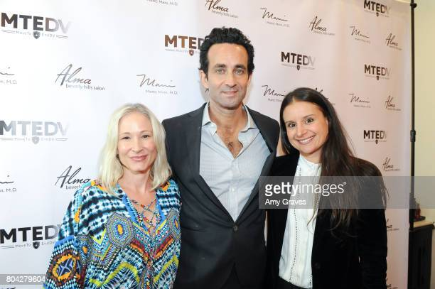 Corie Miller Dr Marc Mani and Natasha Philippides attend A Night Out a fundraising event benefiting #MoveToEndDV hosted by Beverly Hills plastic...