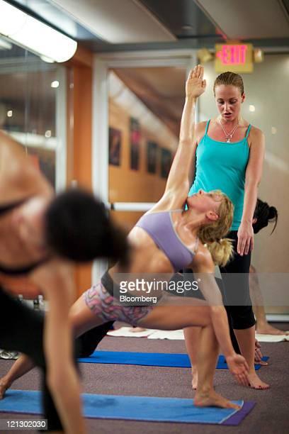 Corina Cotenescu right a crude oil derivatives trader at CEC Futures LLC teaches a Bikram yoga class in New York US on Tuesday Aug 16 2011 Cotenescu...