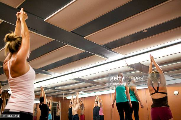 Corina Cotenescu second from right a crude oil derivatives trader at CEC Futures LLC teaches Bikram yoga in New York US on Tuesday Aug 16 2011...