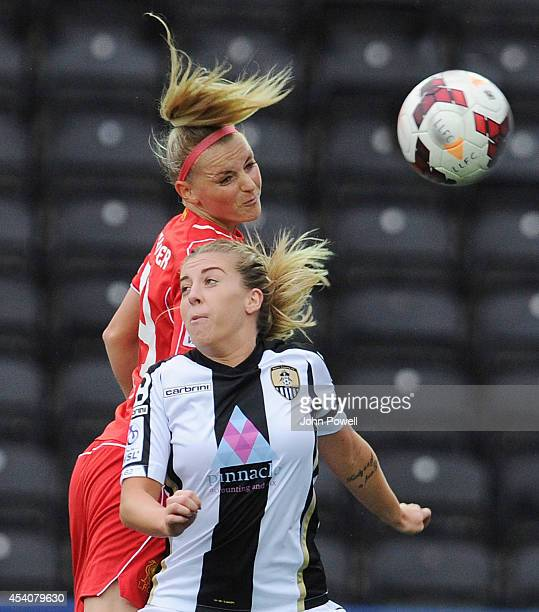 Corina Schroder of Liverpool moves in on Sophie Walton of Notts County at Select Security Stadium on August 24, 2014 in Widnes, England.