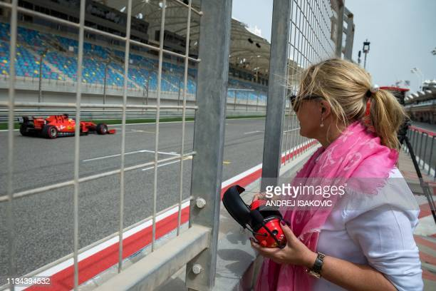 TOPSHOT Corina Schumacher Mick's mother watches her son drive his first laps for Ferrari at the inseason test at the Sakhir circuit in the desert...