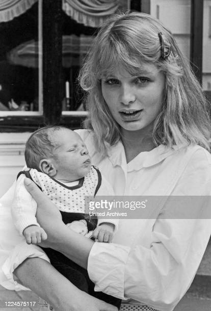 Corinna Drews, wife of German schlager singer Juergen Drews, with baby son Fabian, Germany circa 1981.